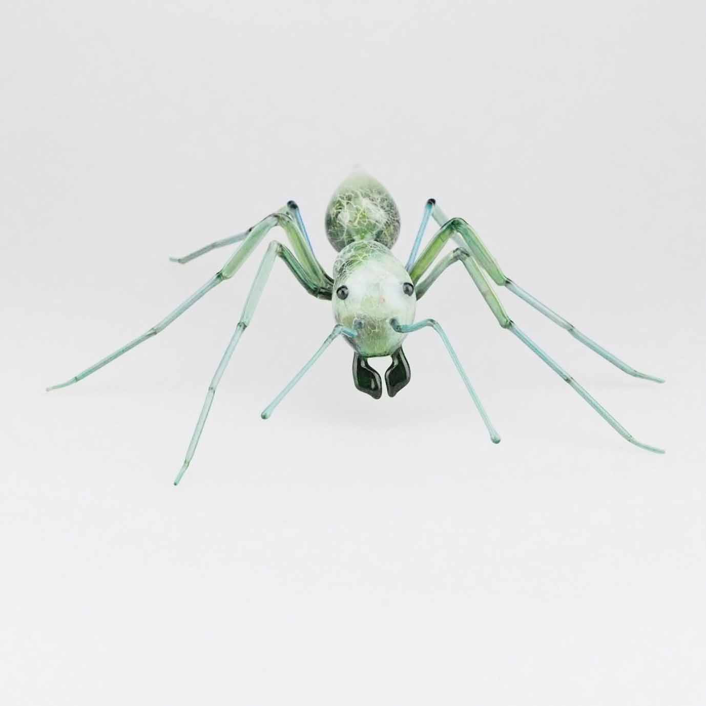 glassblowing green glass ant sculpture